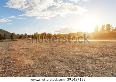 empty ground near lake in summer d day in New Zealand - stock photo