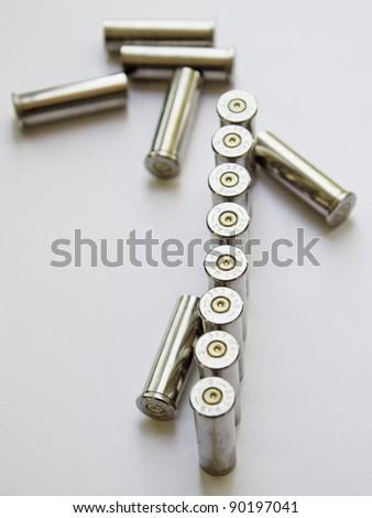 Empty gun cartridges on white background. - stock photo