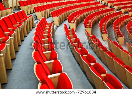 Empty hall for presentation  with red armchairs - stock photo