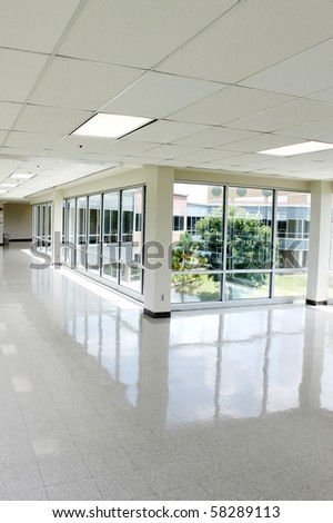 Empty hall with lots of windows - stock photo