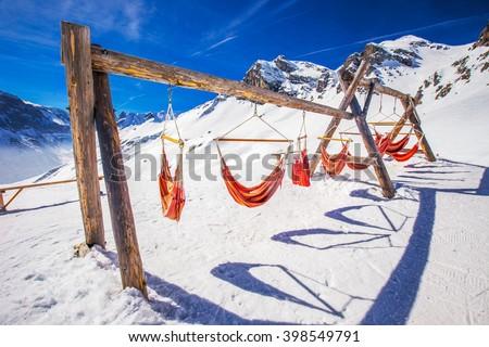 Empty hammocks in Elm ski resort, Switzerland. Elm is famous ski resort with 40 km prepared ski slopes, 4 km tobogganing slopes and children arena.  - stock photo