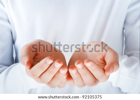 empty hands in the act of presenting something with customizable blank area - stock photo