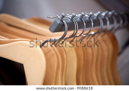 empty hangers in a row at a retail store - stock photo