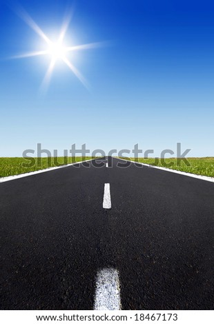 empty highway and the blue sky with sun