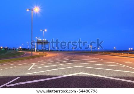 Empty highway at night - stock photo