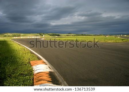 Empty highway, grey sky, cloud. - stock photo
