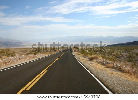 Empty highway in Death Valley in USA - stock photo