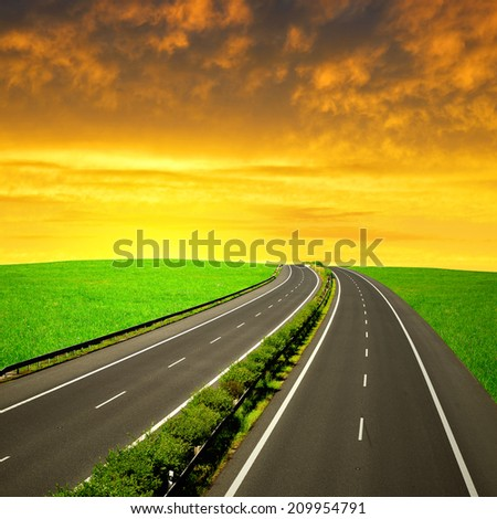 Empty Highway in the sunset - stock photo
