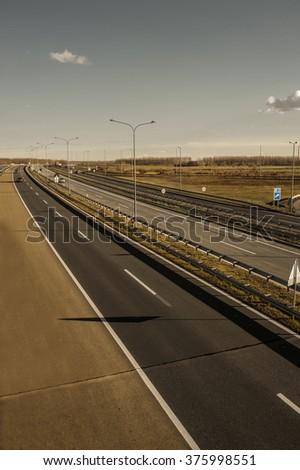 Empty highway on sunset - stock photo
