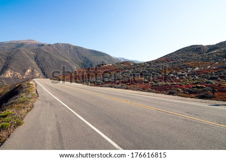 Empty Highway one between the mountains of Pacific coast - stock photo