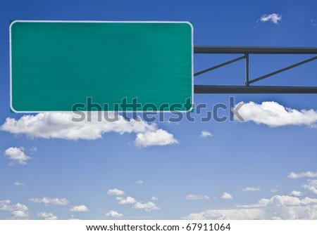 Empty highway sign isolated on cloudy sky - stock photo