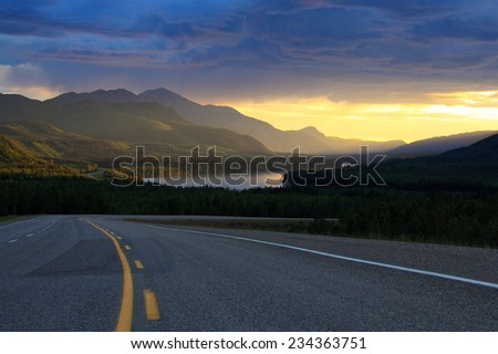 Empty highway through mountains
