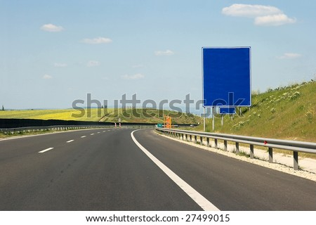 Empty highway with empty signboard - stock photo