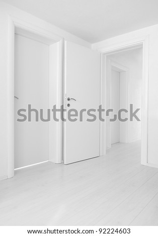 Empty home interior doors and floor - stock photo