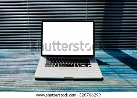 Empty home or office desktop with open laptop computer and blank copy space screen for your text message or content information, distance work concept, mock up display template for advertising  - stock photo