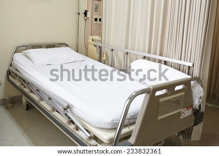 Empty hospital bed after the patient left from recovery - stock photo