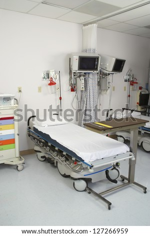 Empty hospital room with gurney and medical tools