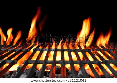 Empty Hot Charcoal Barbecue Grill With Bright Flame On The Black Background - stock photo
