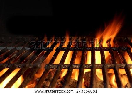 Empty Hot Charcoal Grill With Flames Of Fire On Black Background Closeup - stock photo