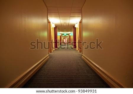 Empty hotel hallway - stock photo