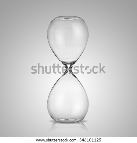 Empty hourglass on gray background - stock photo
