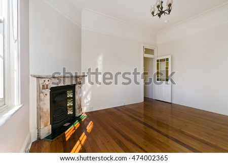 Empty house interior. Spacious family room with clean floor