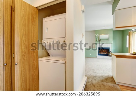 Empty house interior. VIew of laundry appliances built-in the empty wall cabinet - stock photo