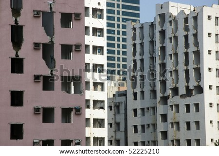 Empty houses, old residential area destroyed and ready for demolition to make space for new skyscrapers in Shenzhen, China. - stock photo