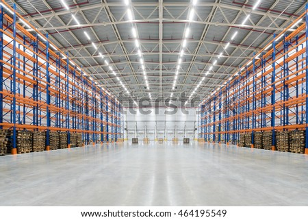 Empty huge distribution warehouse with high shelves and pallet