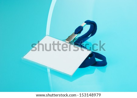 Empty identification tag on blue background  - stock photo