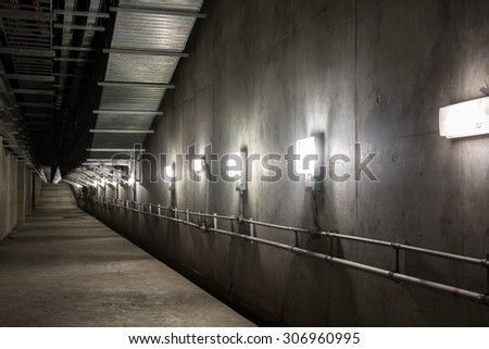 Empty industrial garage room interior with concrete floor and wall background - stock photo