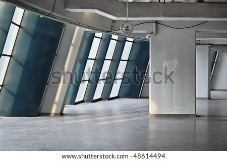 Empty industrial hallway and clock. Modern architecture. - stock photo