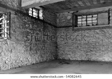 Empty industrial room and textured white wall. Abandoned warehouse interior. - stock photo