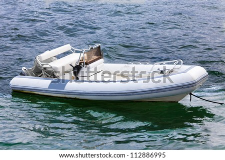 Empty inflatable boat in choppy water