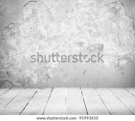 Empty Interior of vintage room of white stone wall and old wooden floor - stock photo