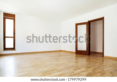 Empty interior room and open door and windows closed - stock photo