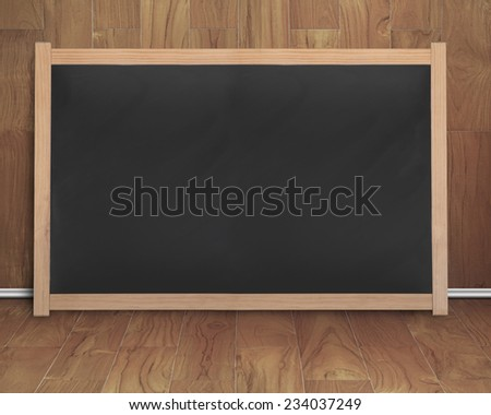 empty interior room with black blank chalkboard on teak wooden wall and floor - stock photo