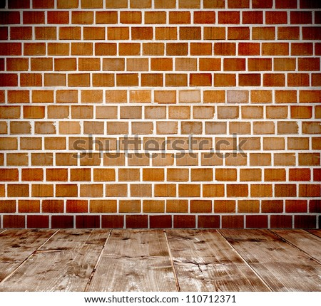 Empty interior room with brick wall and wooden plank floor - stock photo