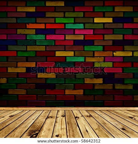 empty interior with wooden floor and multicolored brick wall - stock photo