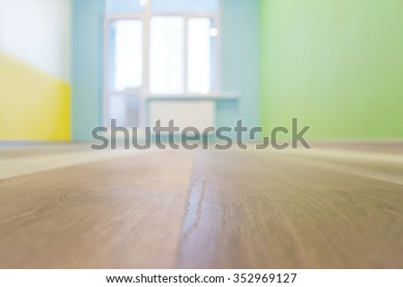 Empty Kids Room Interior Background With Color Walls And Wooden Flooring Shallow Depth Of Focus