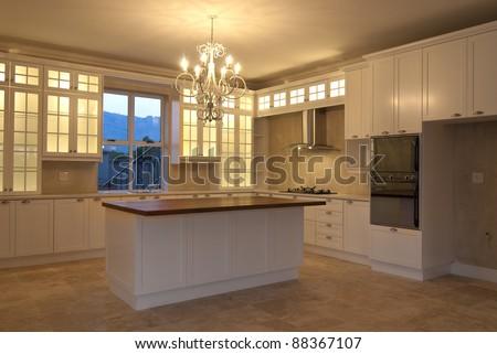 Empty kitchen inside a modern house - stock photo