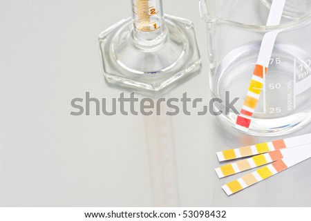 Empty lab chemical containers with PH indicator - stock photo