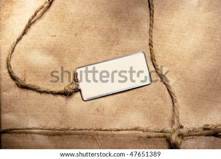 Empty label against a packing paper - stock photo