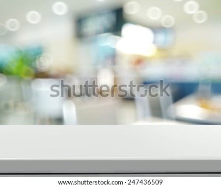 Empty laminate shelf and blurred background for business product presentation - stock photo