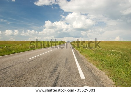 Empty land road with blue sky and clouds
