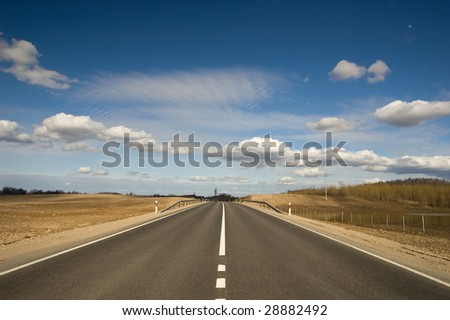 empty land road with deep blue sky - stock photo