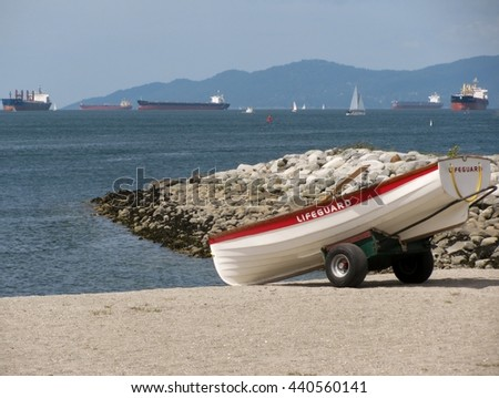 Empty lifeguard rowboat on a trolley at the beach - stock photo