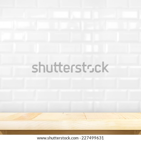 Empty light wood table and blur white ceramic tile brick wall in background,Mock up template for display of your product - stock photo