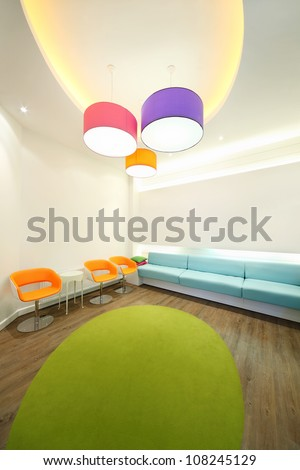 Empty lit room with bright armchairs, soft couches and lamps. - stock photo