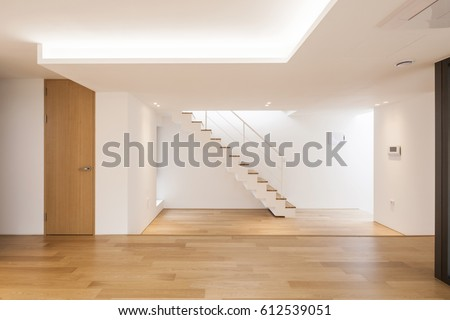 Elegant Empty Living Room With Big Window, Wood Floor, Stair At The Daylight.